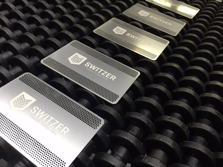 Metal Business Cards on conveyor